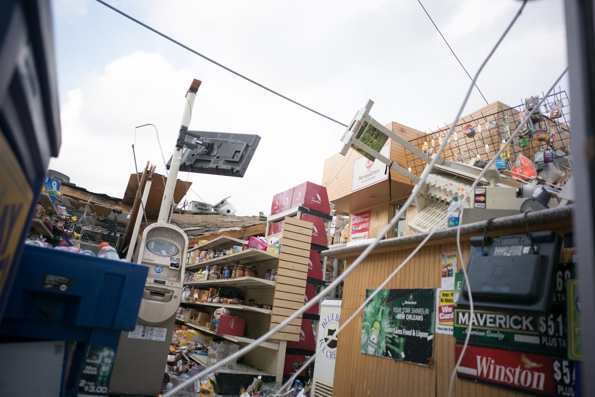 The roof of a convenience store was completely removed by the tornado.