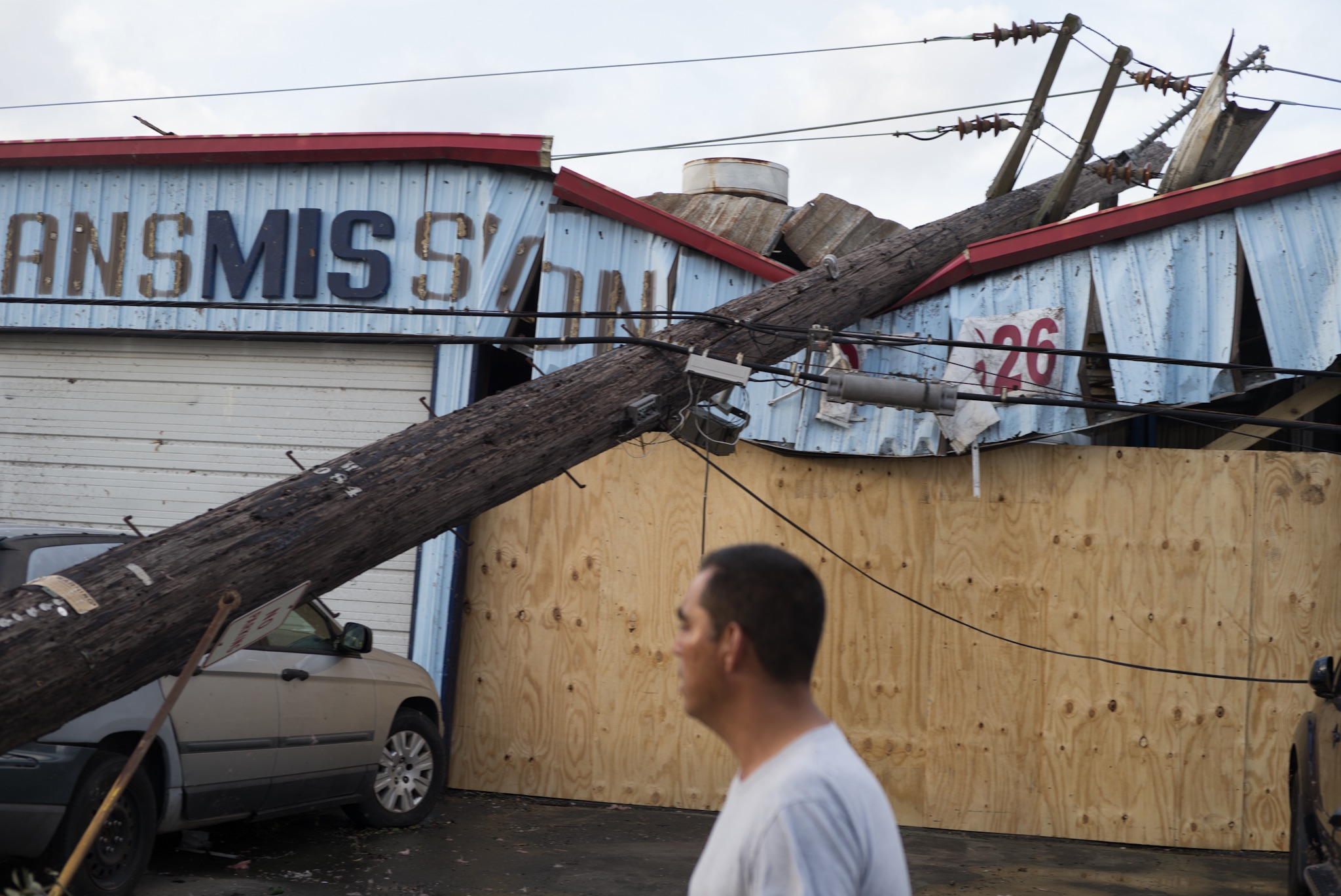While many business along Chef Menteur Highway were spared direct damage from the tornado, several fell victim to the domino like topple of power lines.