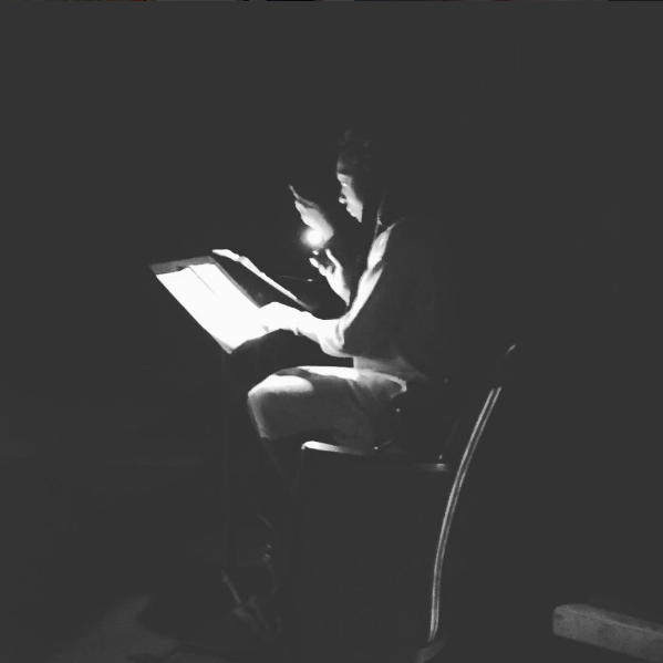 Here is a photo taken with my cell phone of Porscha Shaw reading her script by cell phone light. Cell phones! Here to stay.