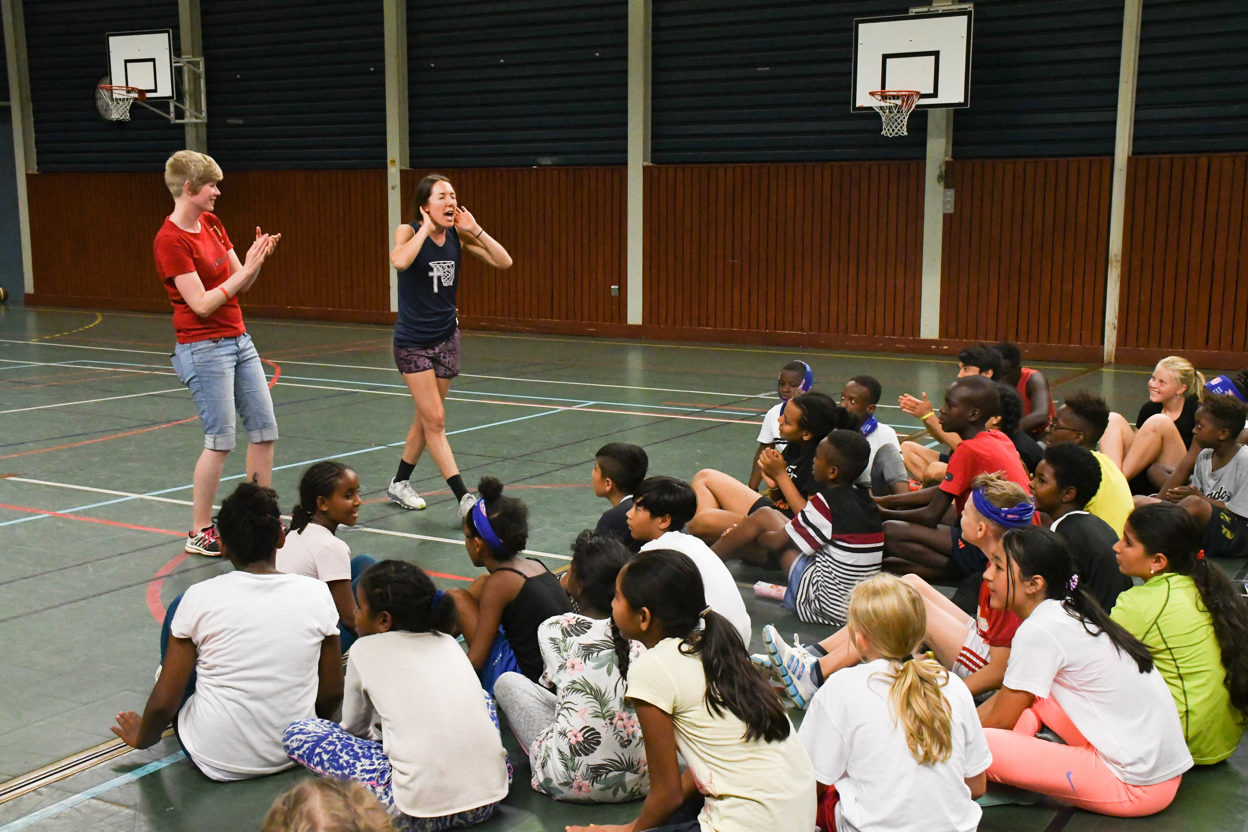 Women's tour leader Cassie Bates pumping up our campers at  our hoop camp in Hammarstrand, Sweden.