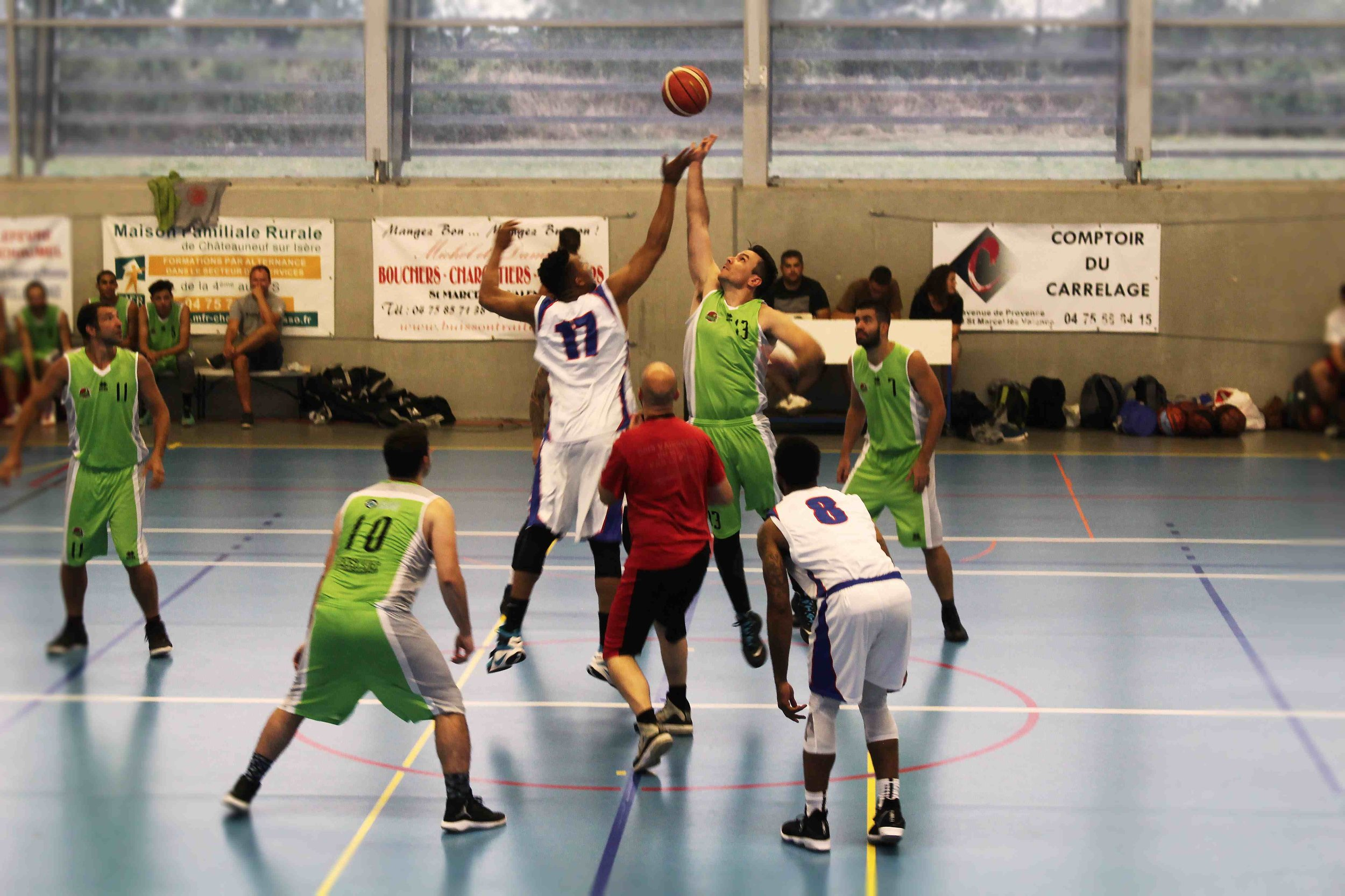 News Release players (in white) playing against a European pro team overseas.