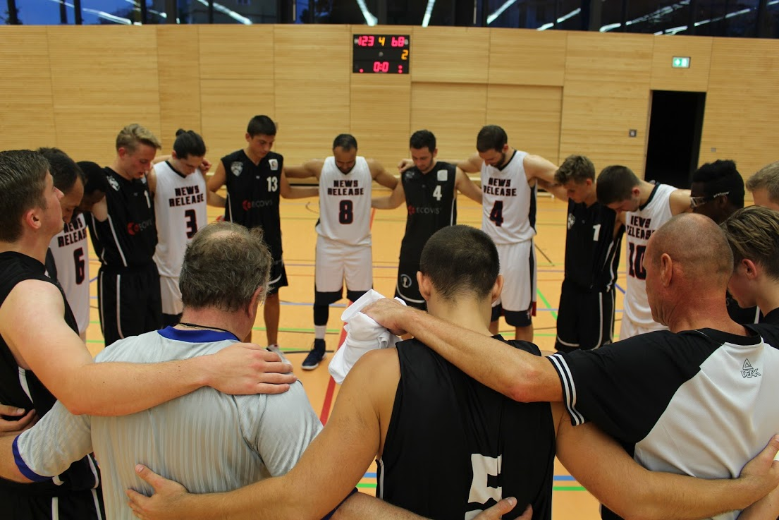 Our players praying together with their opponents and officials before a game.