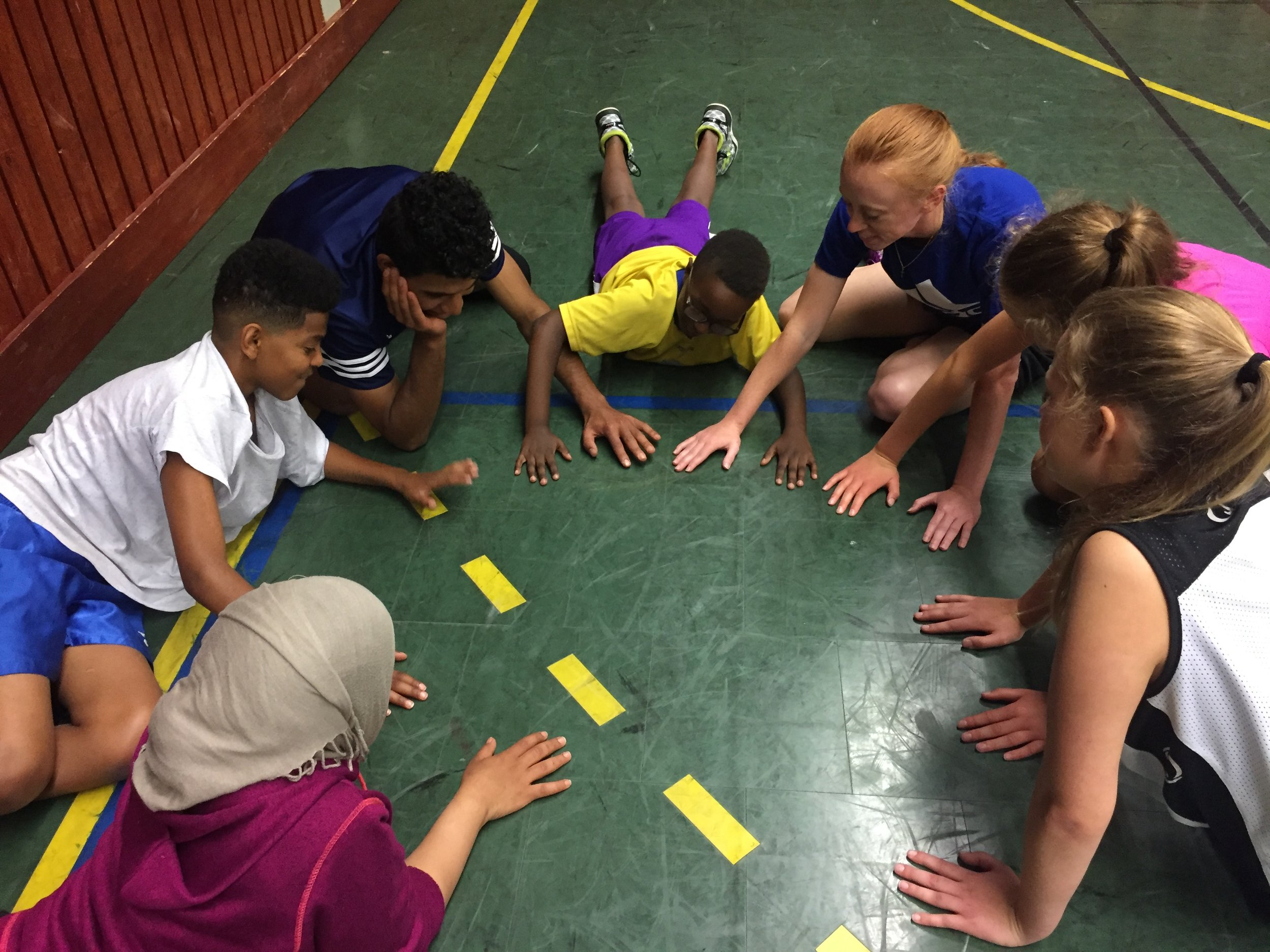 Building relationships with our campers through playing a fun game with them at our kids basketball camp in Sweden.