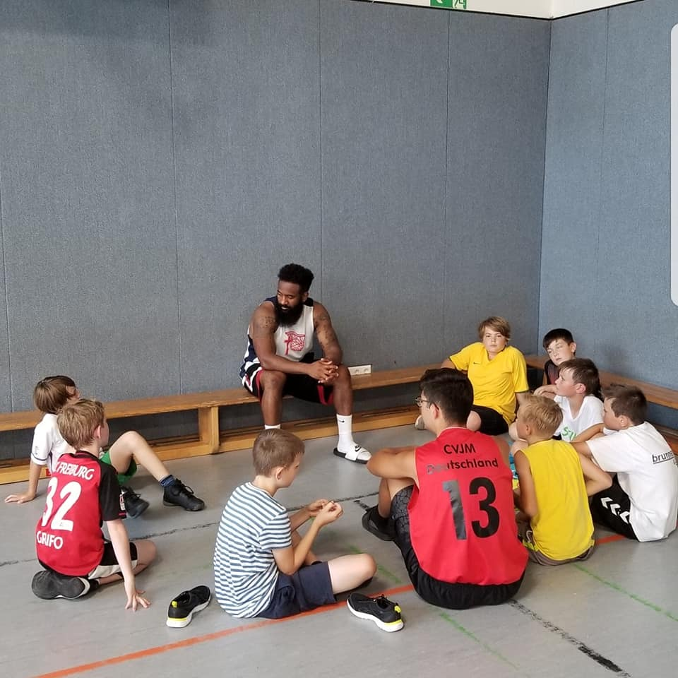 One of our players sharing the Gospel and telling the kids at camp about Jesus.