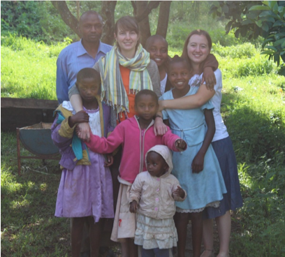 Sarah with her host family in 2012