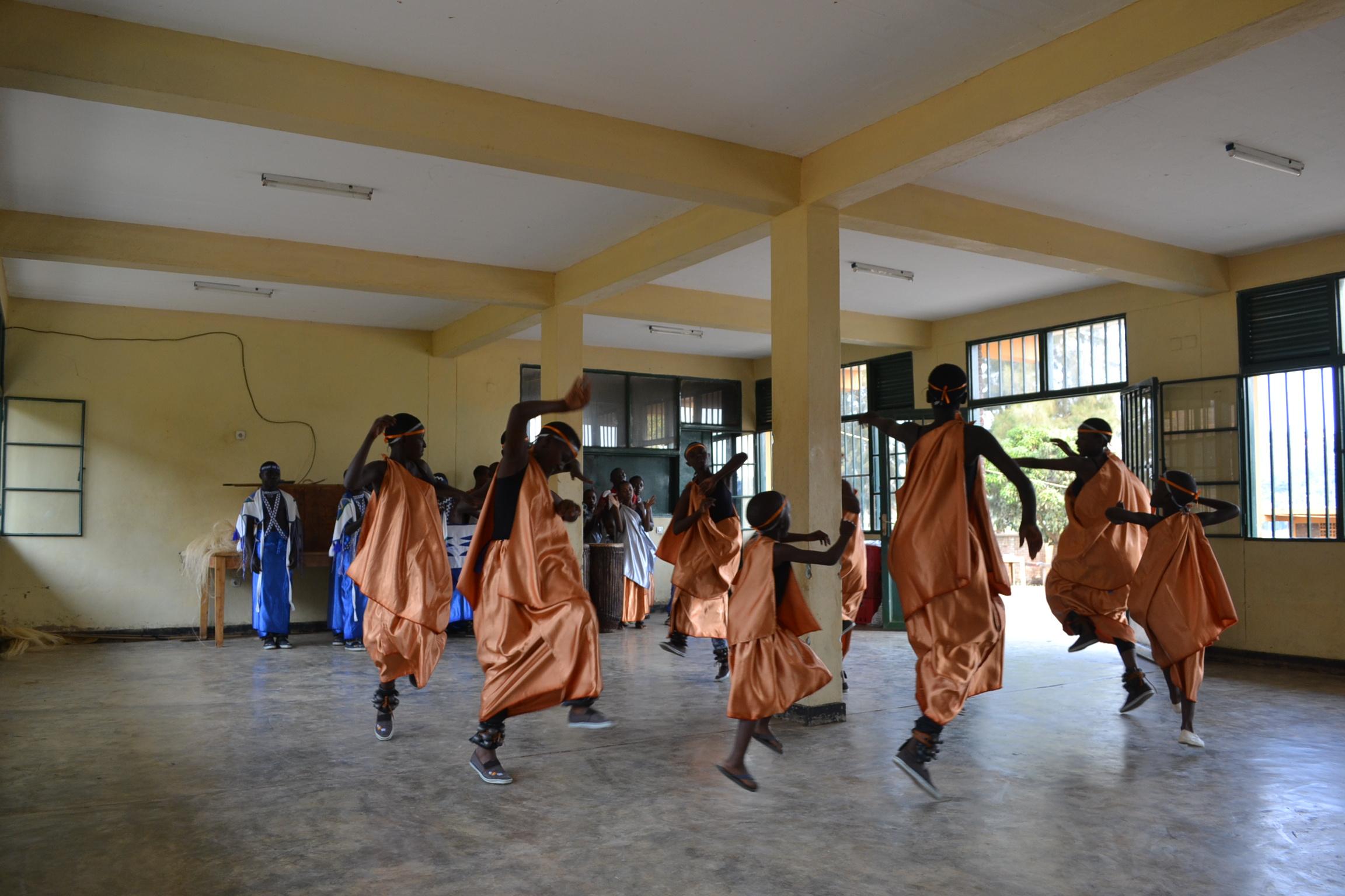Rwandan girls telling stories through traditional dance