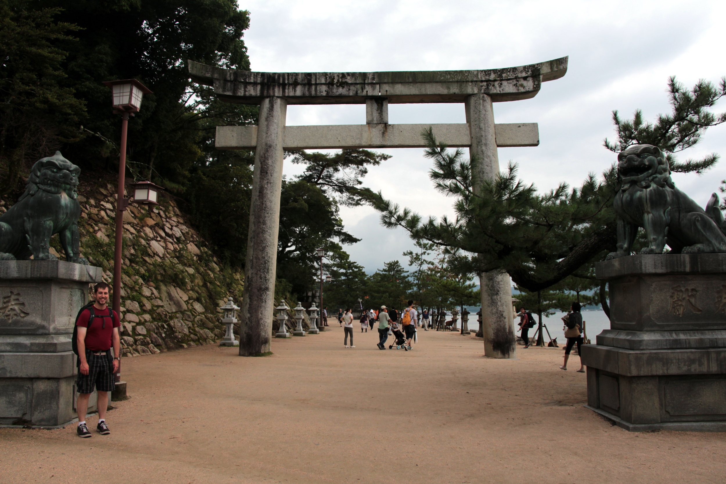 A large torii gate on Miyajima. We have seen gates made of stone and wood. Note the two lions, one on each side of the gate. Some gates have guardian statues such as these. One of the guardians will have its mouth open, the other closed.