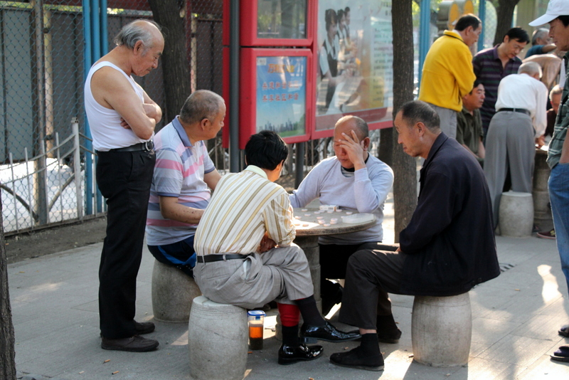 Just like in Boston's Chinatown, older men in China often sit outside playing Chinese Chess. Andrew learned to play last night with our couchsurfing hostess.