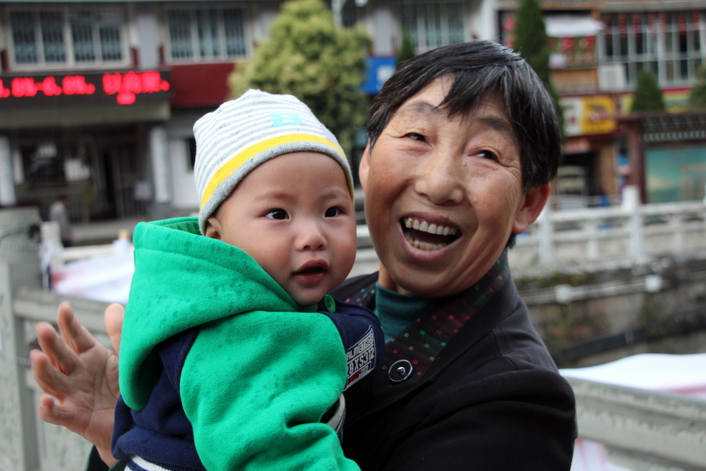Babies and children in China love Andrew. I took a photo of this awesome baby and grandma.