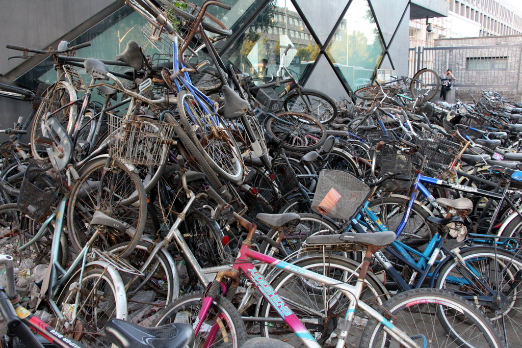 Beijing: We're not sure why there was this massive pile up of bicycles was here outside of the subway station, but we found it interesting enough to take a photo of it