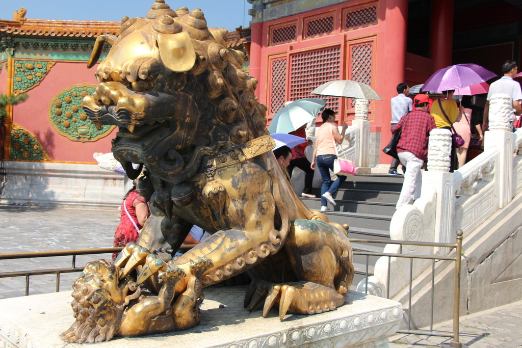 Beijing: Whenever you see the lions in front of a gate, one is for the empress, signified by the cub under her paw symbolizing the fertility of the Imperial Family...
