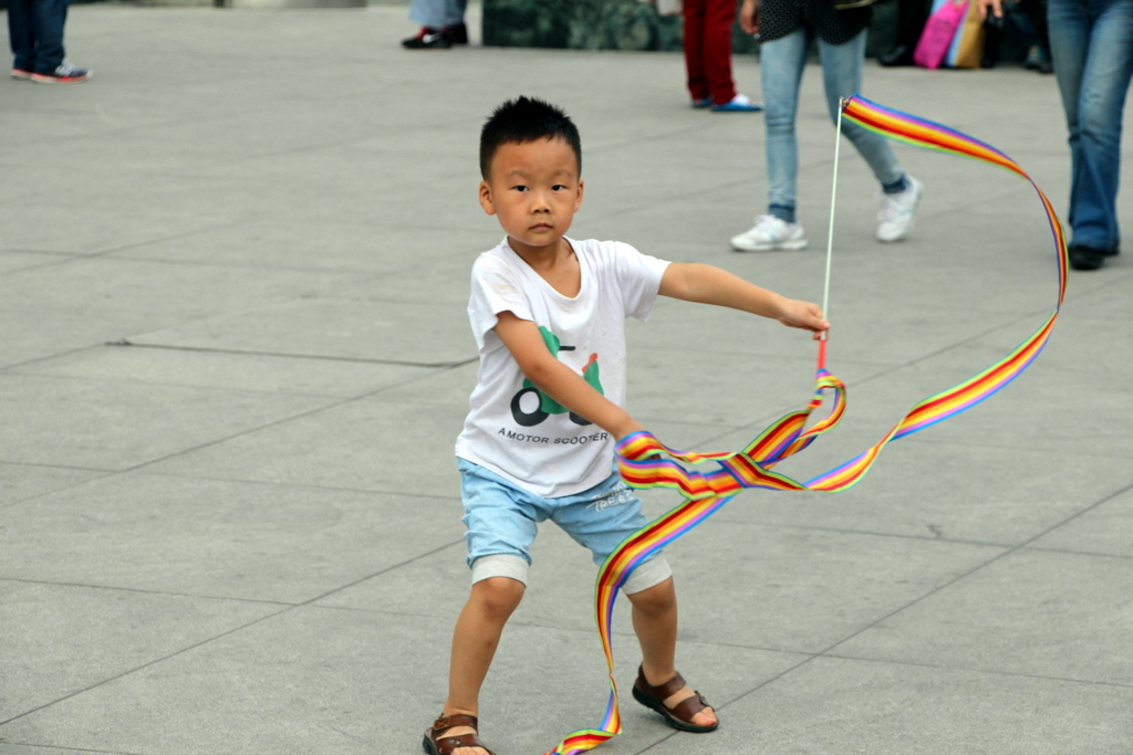 Chengdu: This cute kid was twirling a ribbon in the central plaza to celebrate China's National Holiday