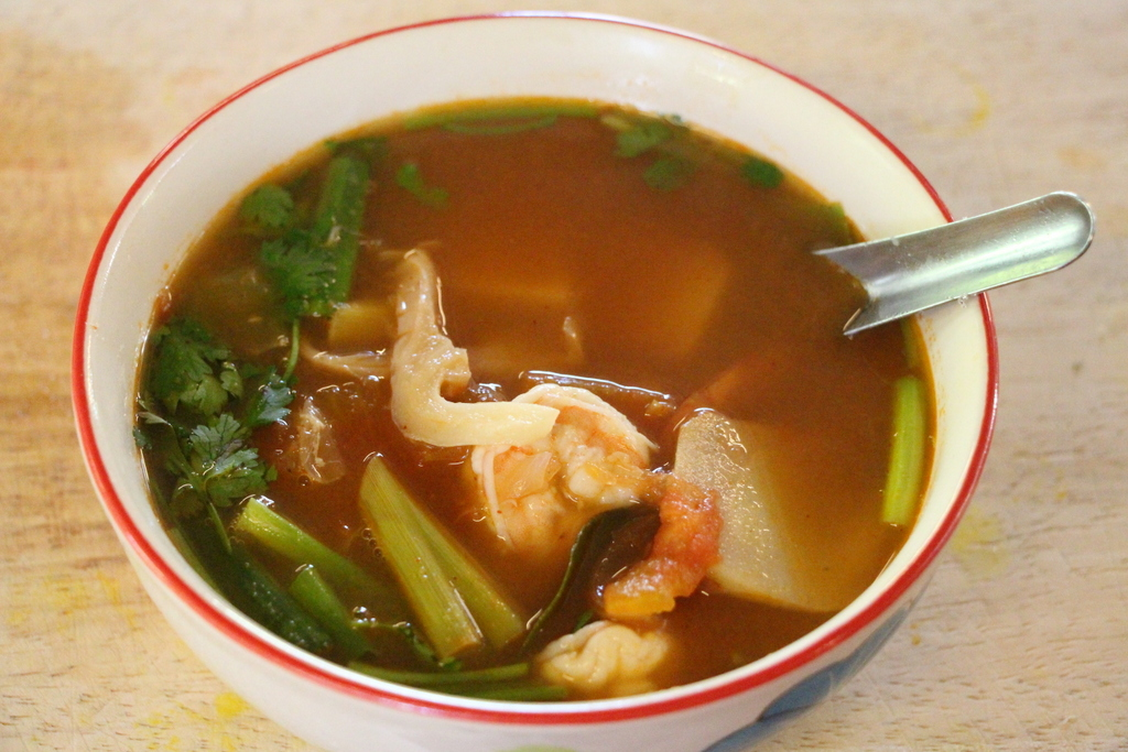 My tom yum goong - a sweet and spicy tomato broth with shrimp.