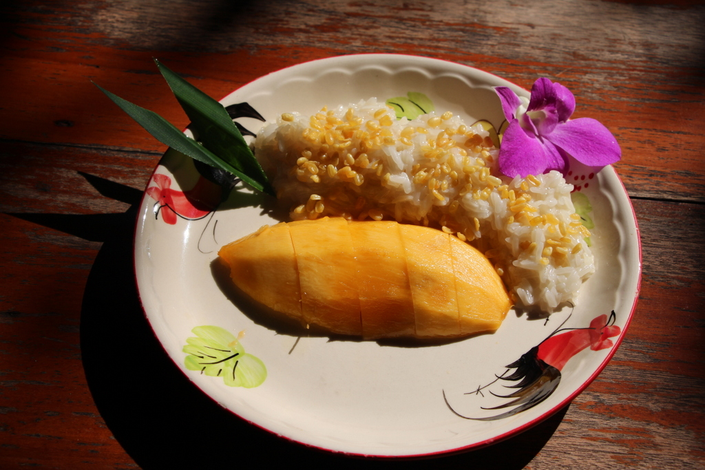 Mango sticky rice is our #1 favorite food in all of Thailand. Steamed rice is made sticky with sweetened coconut milk. It is served alongside a luscious cut of mango and topped with fried mung bean sprouts (they taste like rice krispies!)