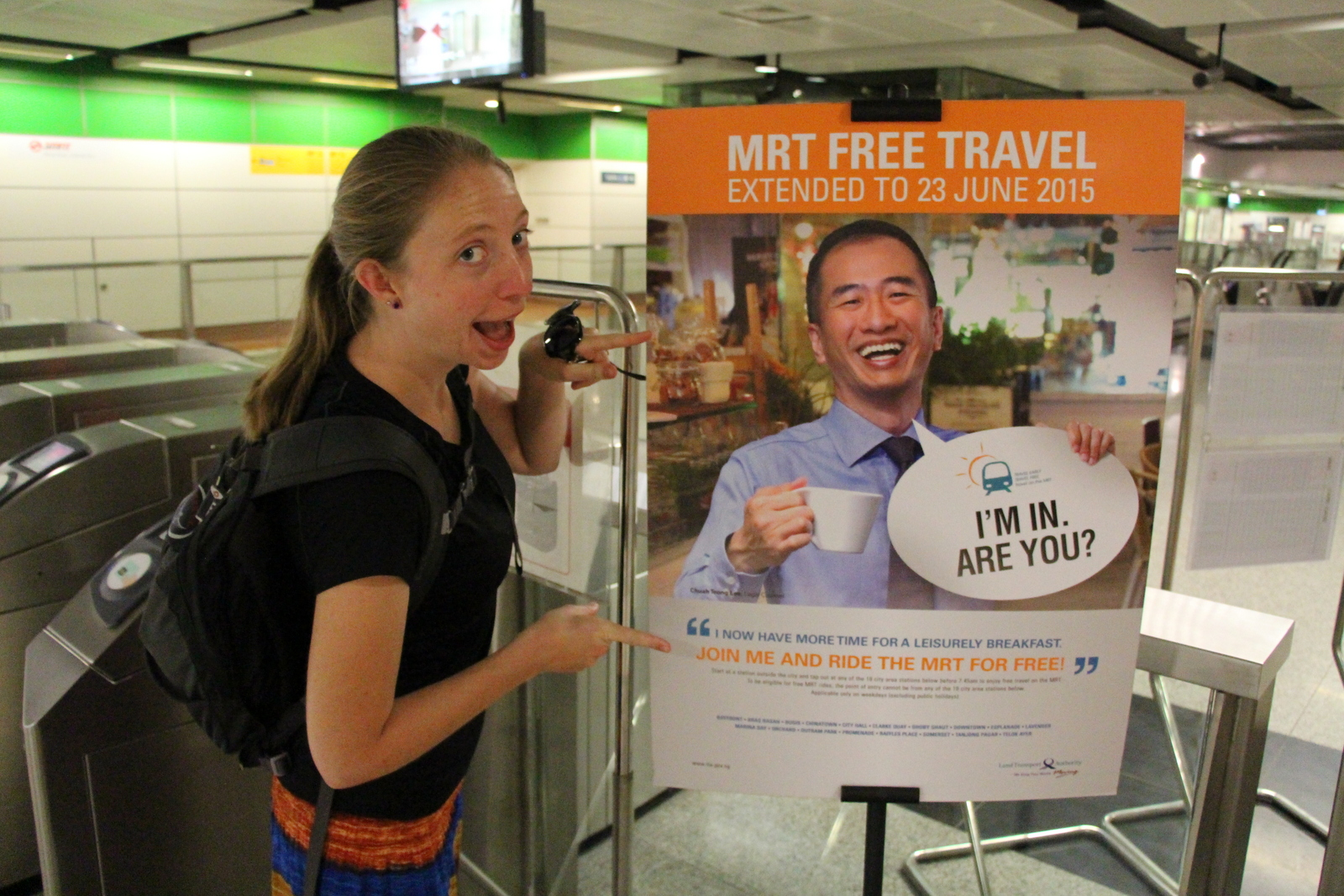 Kelsi reads the sign explaining the free metro ride program for early commuters