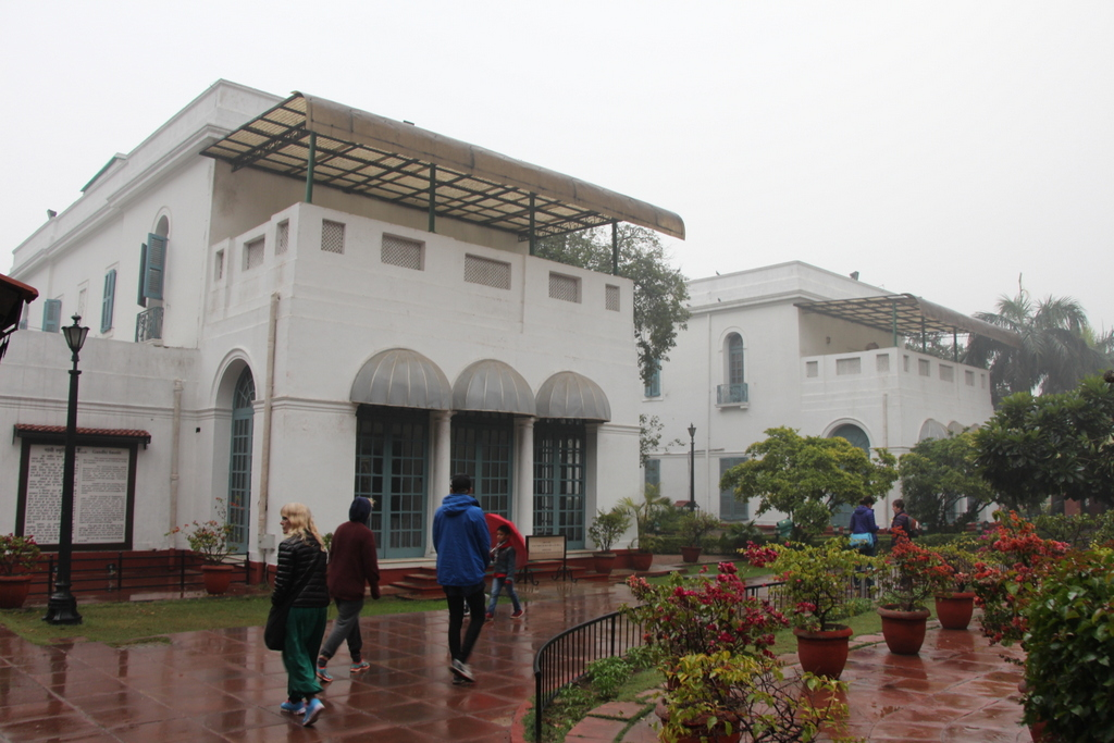 Outside the museum. The room just off center of the photo with three glass double doors is the room in which Gandhi spent most of his time.