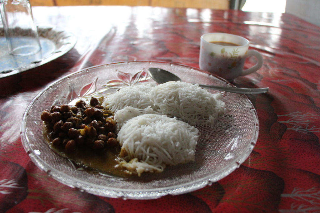 Chickpeas, string hoppers, and masala chai for breakfast in Alleppey.