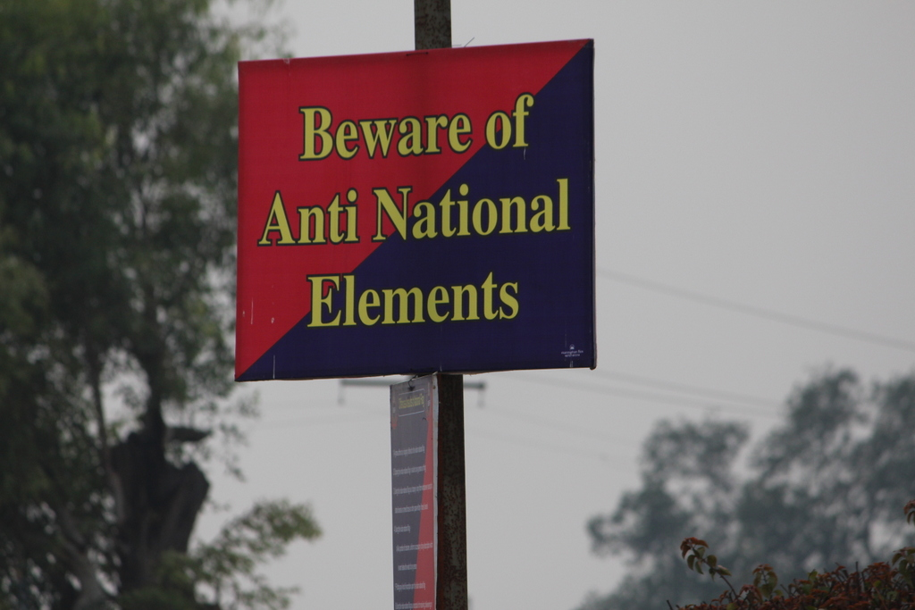 A warning sign as we approach the Wagah Border with Pakistan from the Indian side