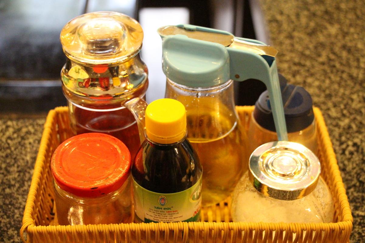 Vietnamese condiments (back row, from left) fish sauce, rice wine vinegar, salt, (front row) honey, molasses, salt.
