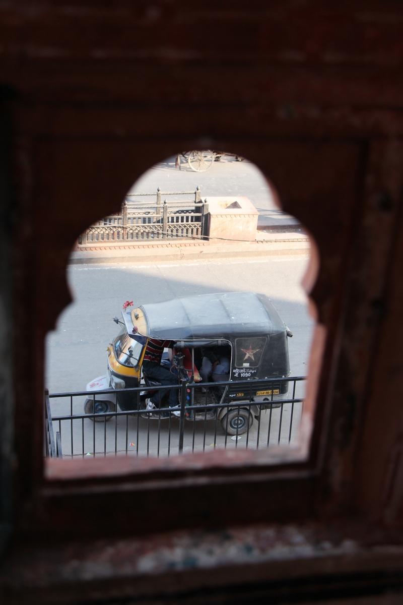 A tuk-tuk await on the street in Jaipur