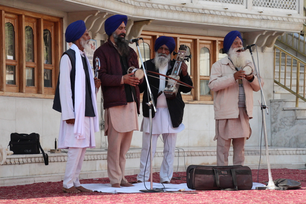 A Sikh band plays at the walkway around the tank, making it pleasant for pilgrims and visitors to sit and listen