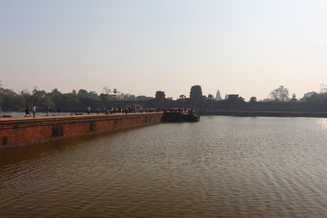 The view of the bridge that leads to Angkor Wat. This photo was taken on our way out of Akgkor Wat... After the sun had risen.
