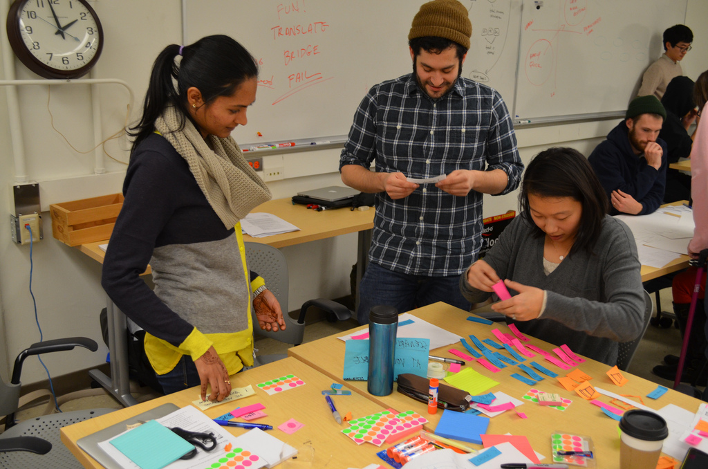 Testing our prototype with our classmates. Managing the options and picking up the right Post-its is harder than it looks.