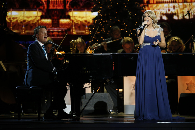 "Michael W. Smith and Carrie Underwood perform at the ""CMA Country Christmas"" taping on Friday, Nov. 7, 2014 at the Bridgestone Arena in downtown Nashville. The holiday special airs Monday, Dec. 1 at 8/7c on the ABC Television Network."