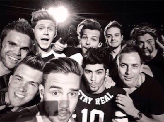 Drummer Josh Devine with One Direction band mates