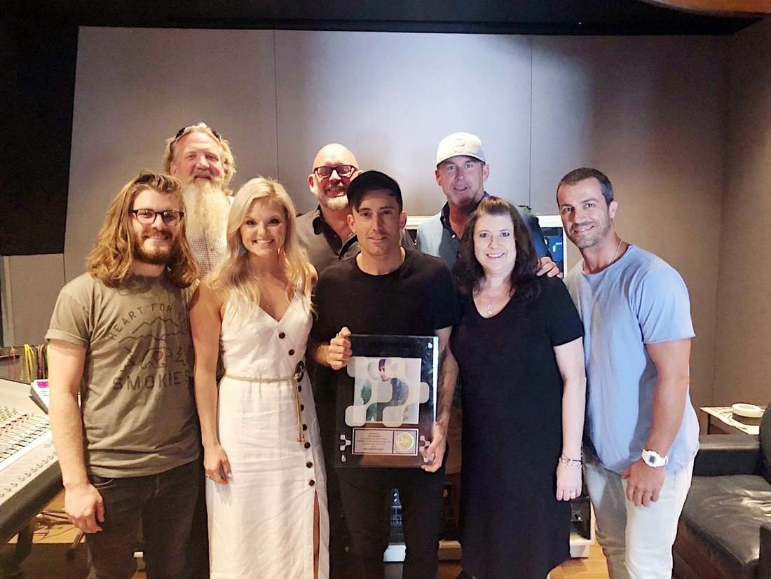 L-R Front: Dan Franquemont (Spotify), Brittany Schaffer (Spotify), Phil Wickham, Kim Davis (BrickHouse Entertainment), Kevin Huffman (WME) L-R Back: Scott Brickell (BrickHouse Entertainment), Jeff Moseley (FairTrade Services), Mike Snider (WME)