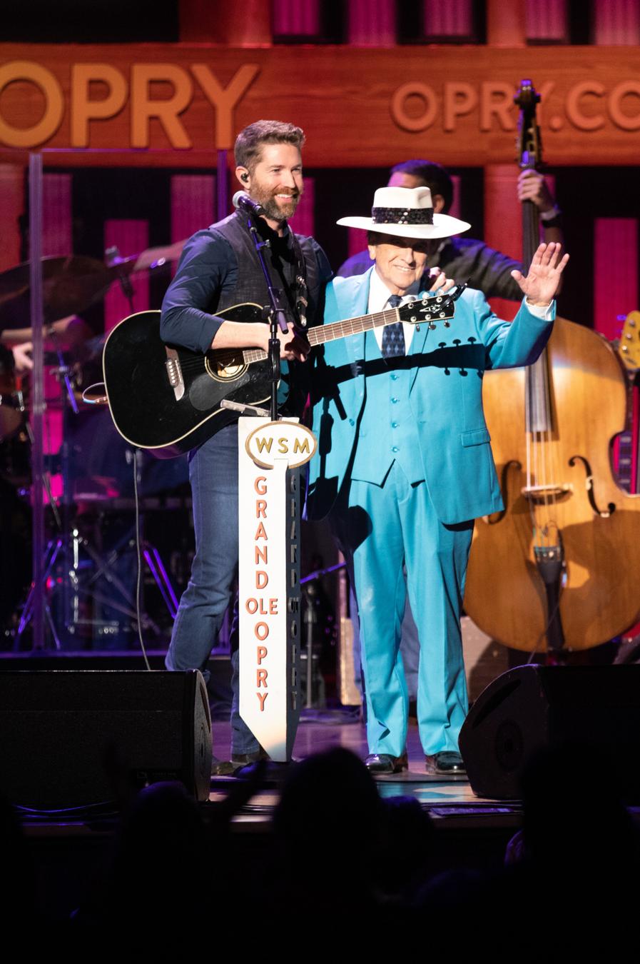 From L to R: Josh Turner with Bobby Osborne  Photo courtesy Grand Ole Opry LLC. Chris Hollo, photographer