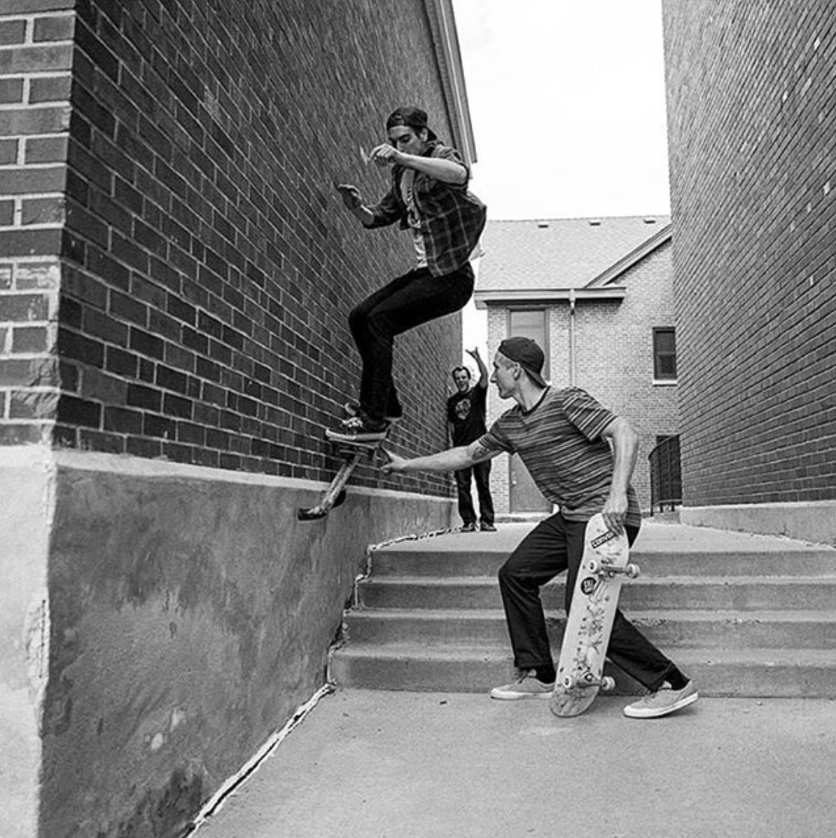 Frontside 50-50 by Max Matekis, assisted by TJ Moran and Jan Jacobson.