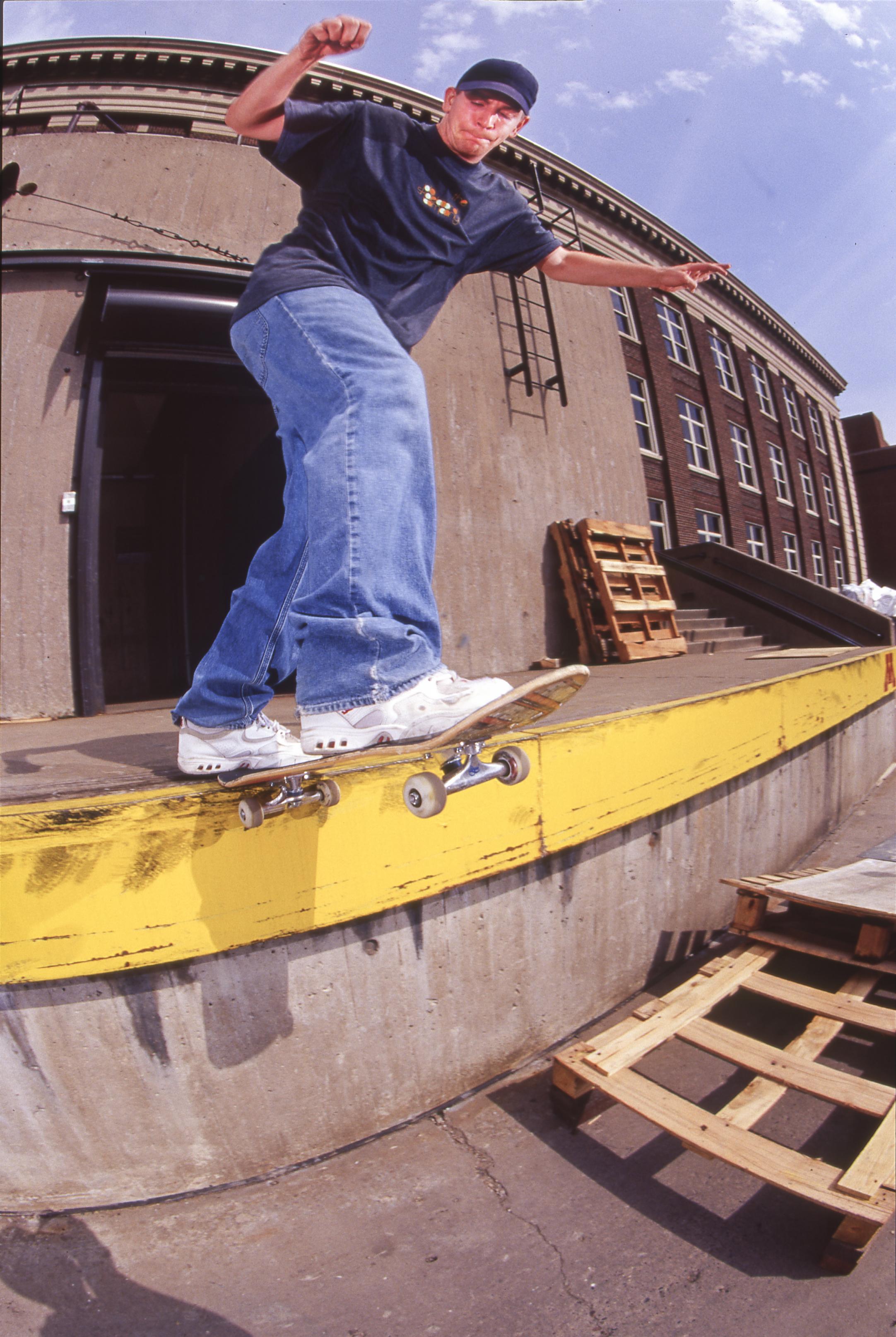 Chad Benson backside tailslide at the University of Minnesota.