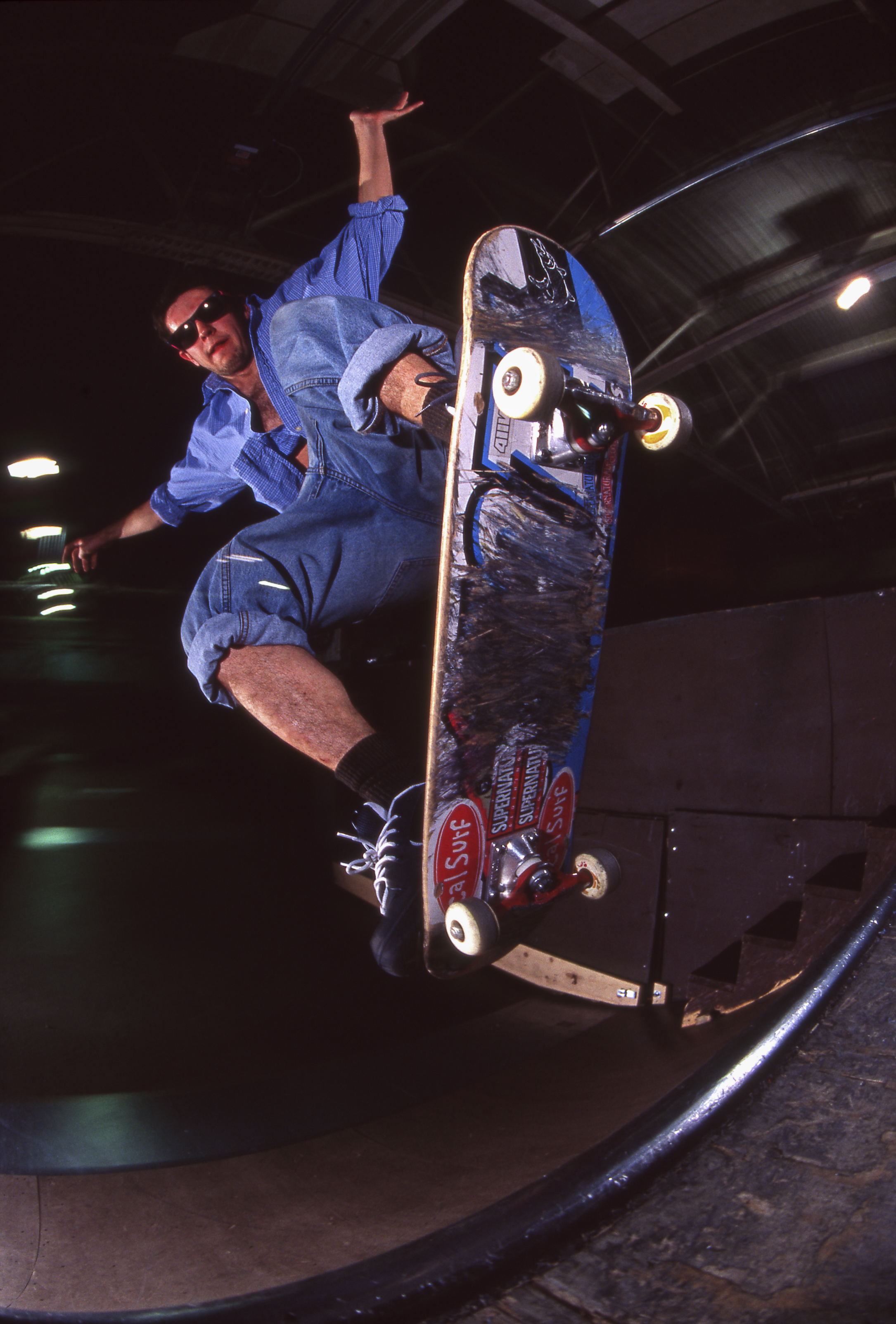 VP contributor  Mike Munzenrider doing a blunt fakie on a 7.5 board with rolled up jeans and red Royal trucks, very early aughts.