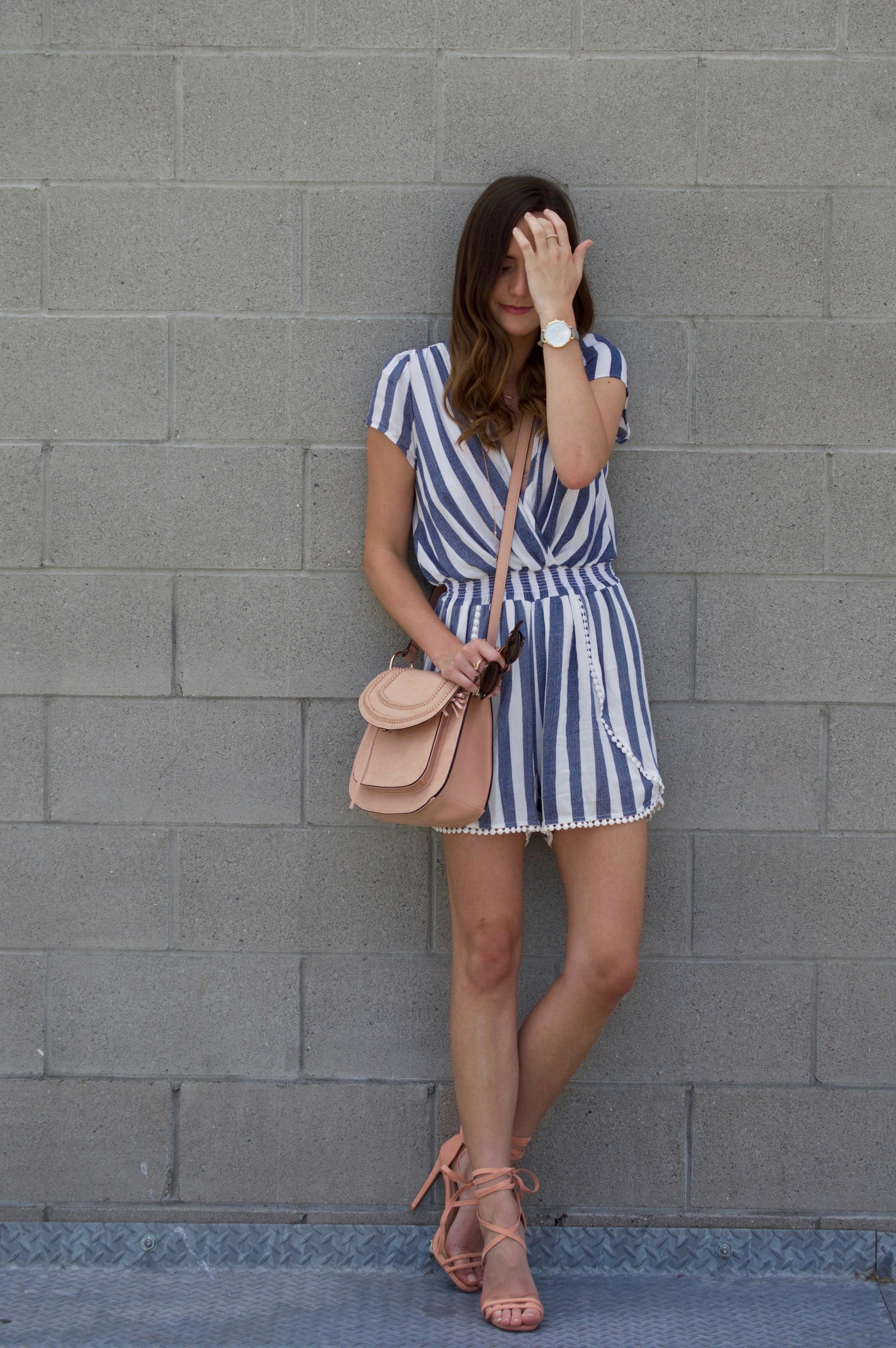 Shop the Look Below. Romper: c/o  J.Coda Clothing . Shoes: c/o  Make Me Chic . Bag: Franco Sarto via TJMaxx—similar below. Watch:  ILY Couture . Necklace:  Nordstrom . Rings: c/o  BaubleBar . Sunglasses:  Ray-Ban .
