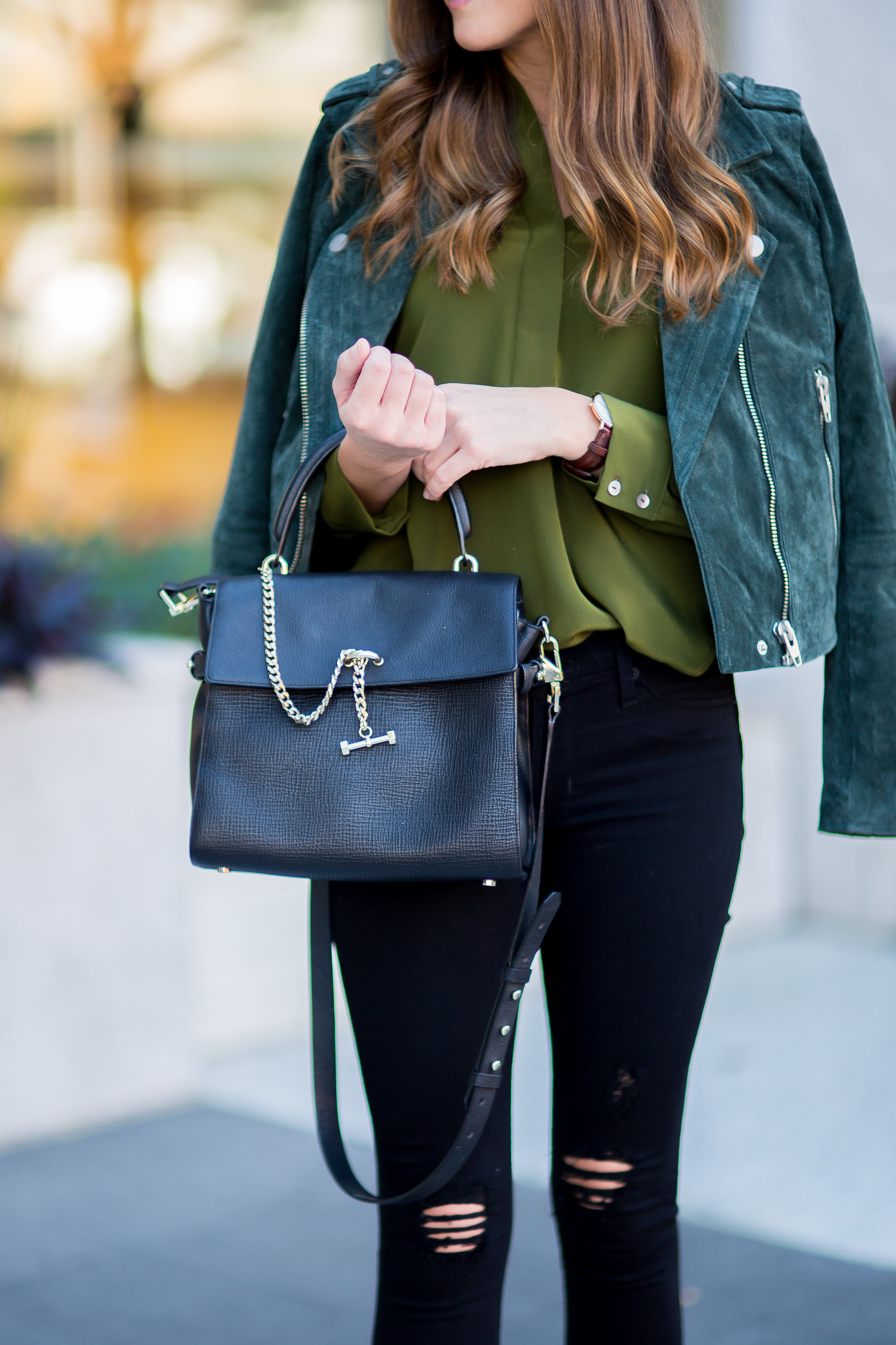 Shop the Look Below. Top:  Amour Vert  c/o. Jeans. Hudson. Similar  here . Jacket: Tj Maxx. Similar  here . Booties:  Coconuts by Matisse . Bag:  Luana Italy  c/o. Watch:  Daniel Wellington  c/o. Photos by  Baley Marie Photography