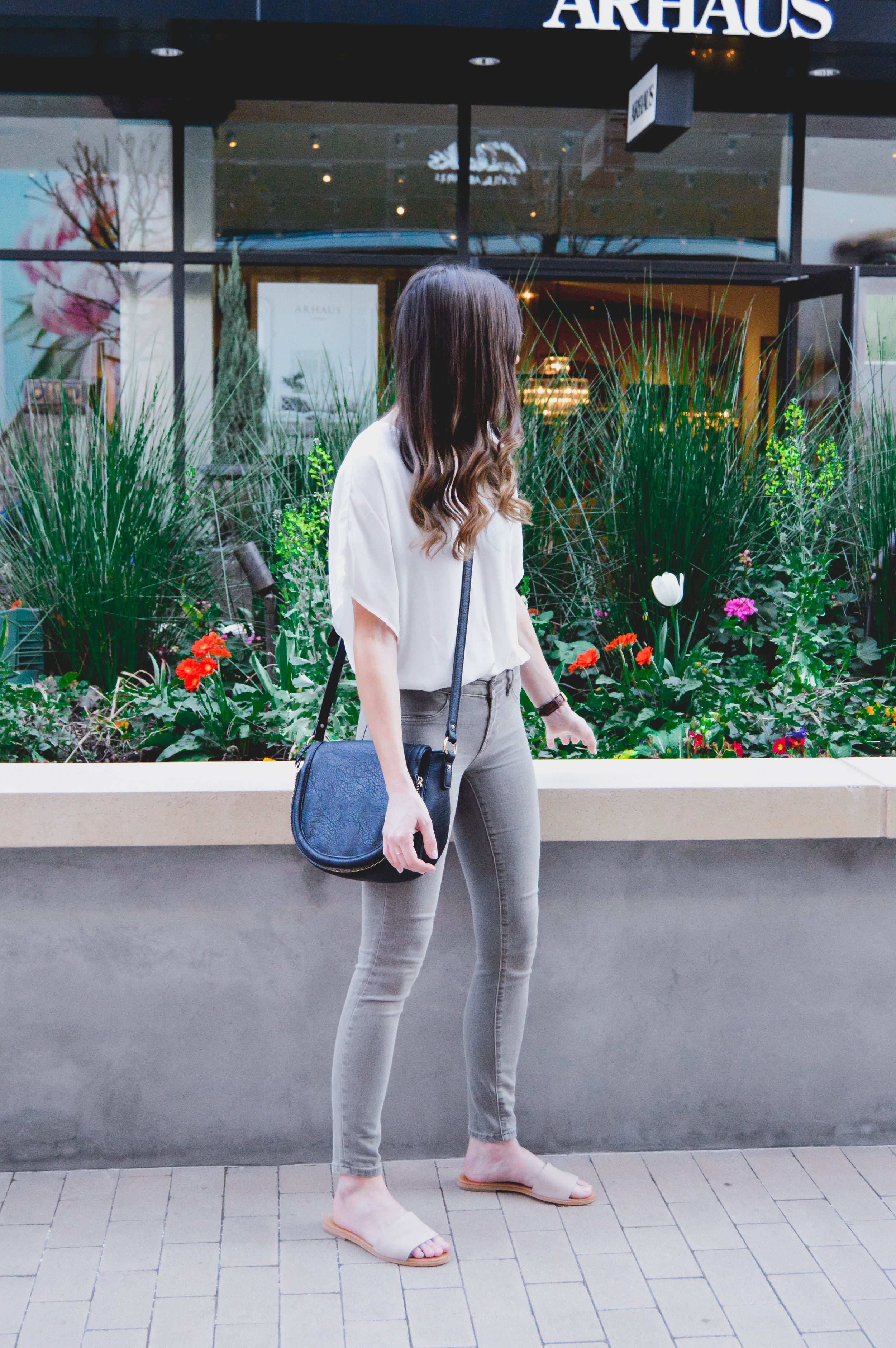 Olive jeans and white top outfit