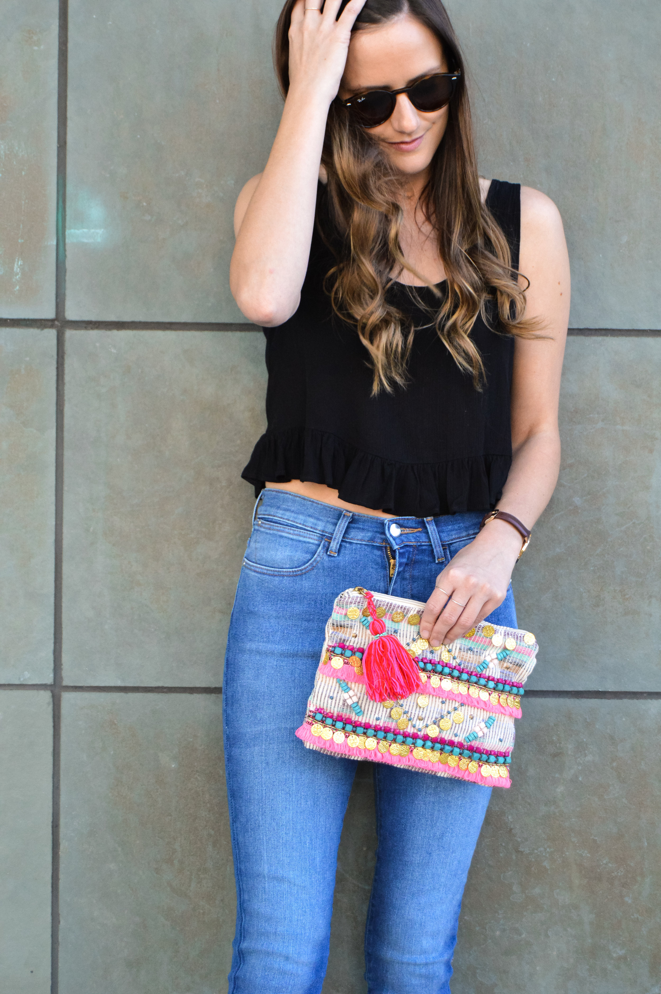 Summer style black crop top and skinny jeans