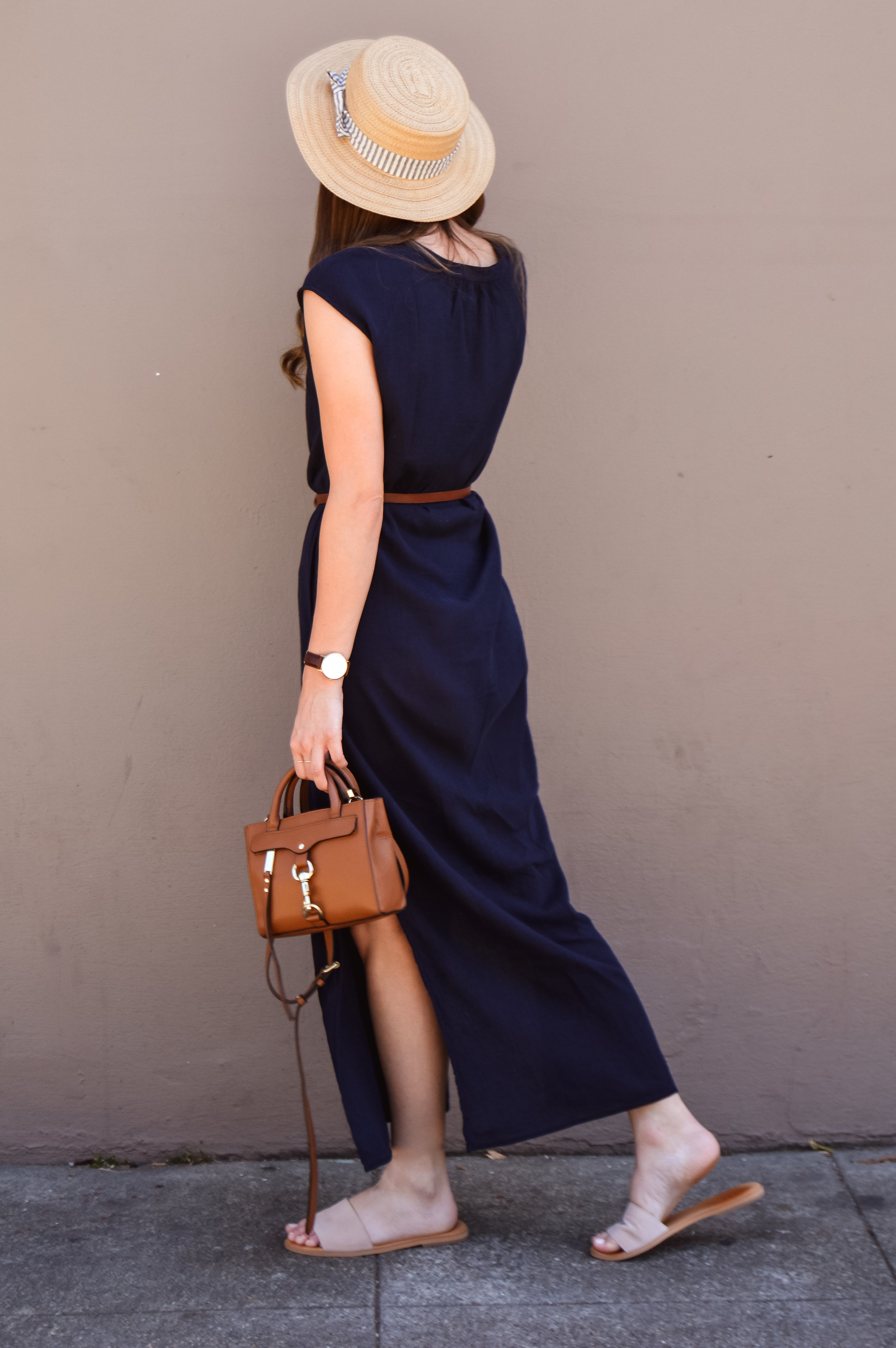 Vacation style navy maxi dress and boater hat