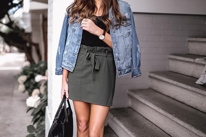 Olive miniskirt and distressed denim jacket