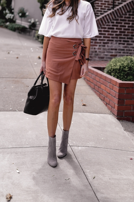 Miniskirt and grey suede booties