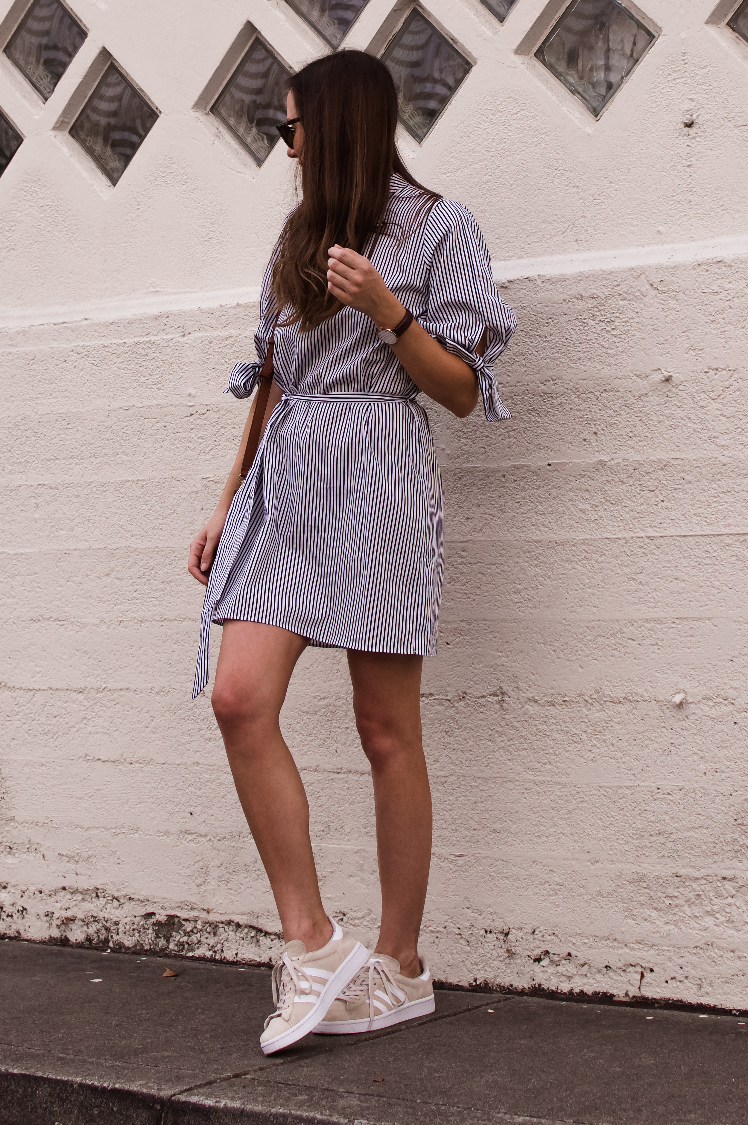 Shop the Look Below.  Topshop Dress  |  Adidas Sneakers  |  Madewell Bag  |  Ray-Ban Sunglasses