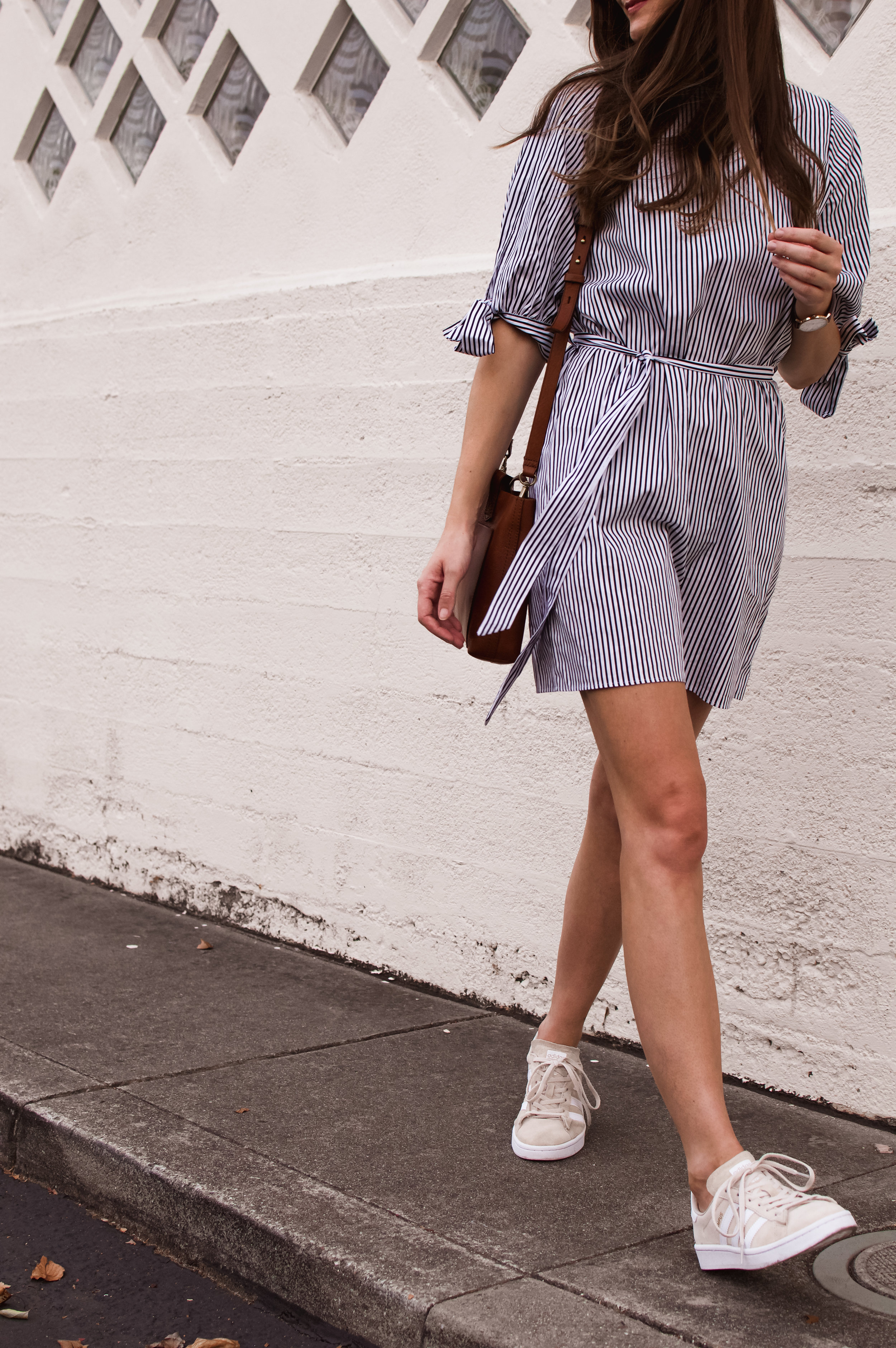 striped shirt dress and sneakers