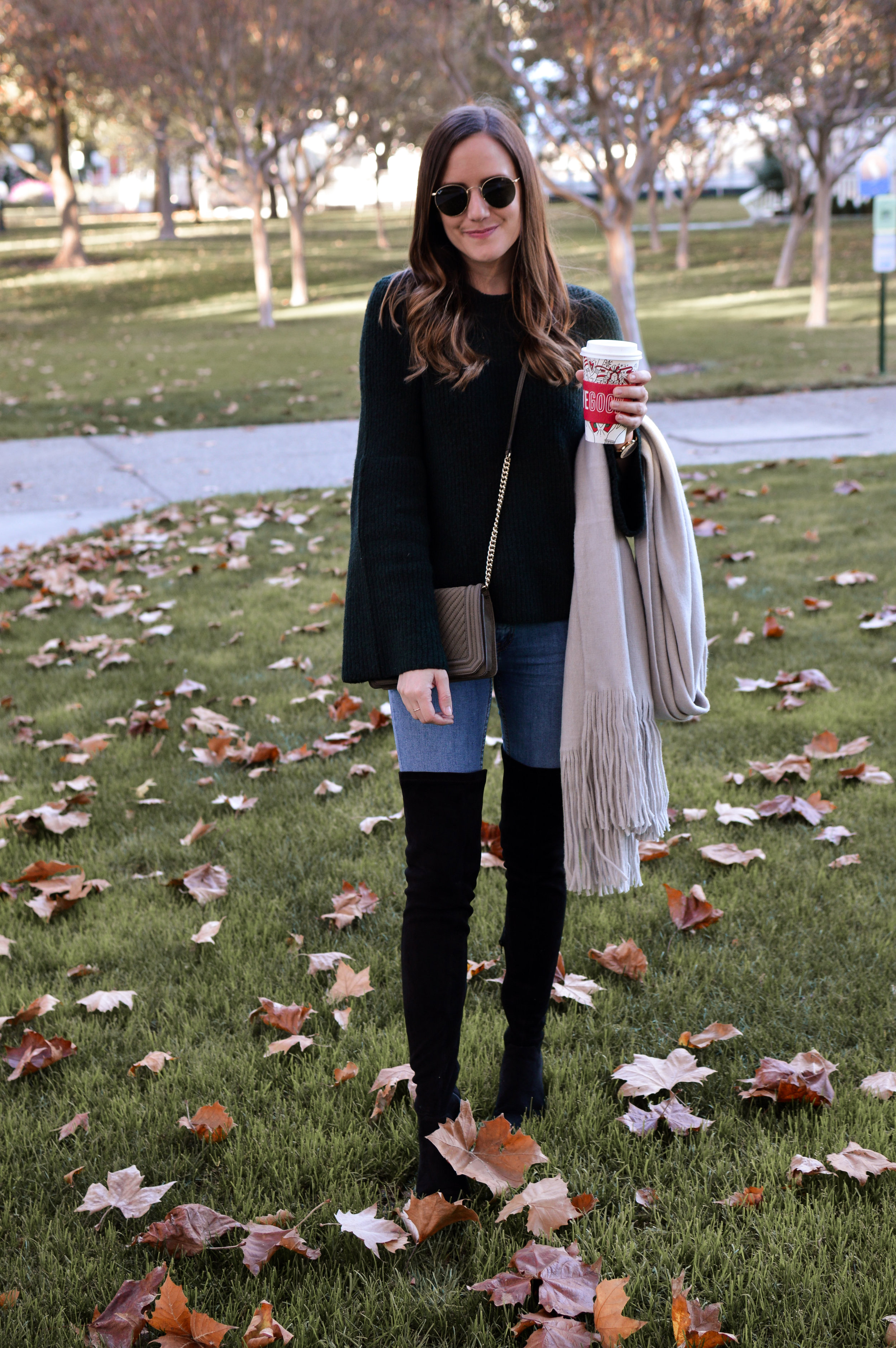 Shop the Look Below.  Madewell Sweater  |  Free People Jeans  |  Steve Madden Boots  |  Free People Scarf  |  Ray-Ban Sunglasses