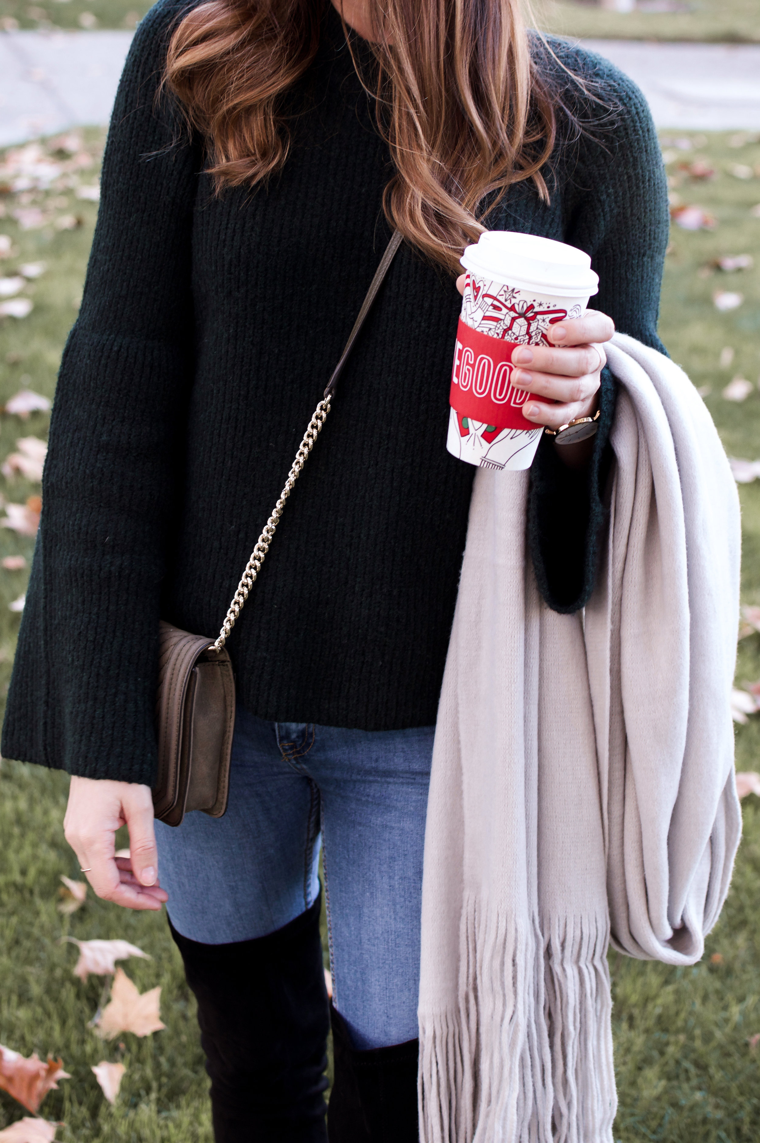 grey scarf and black sweater