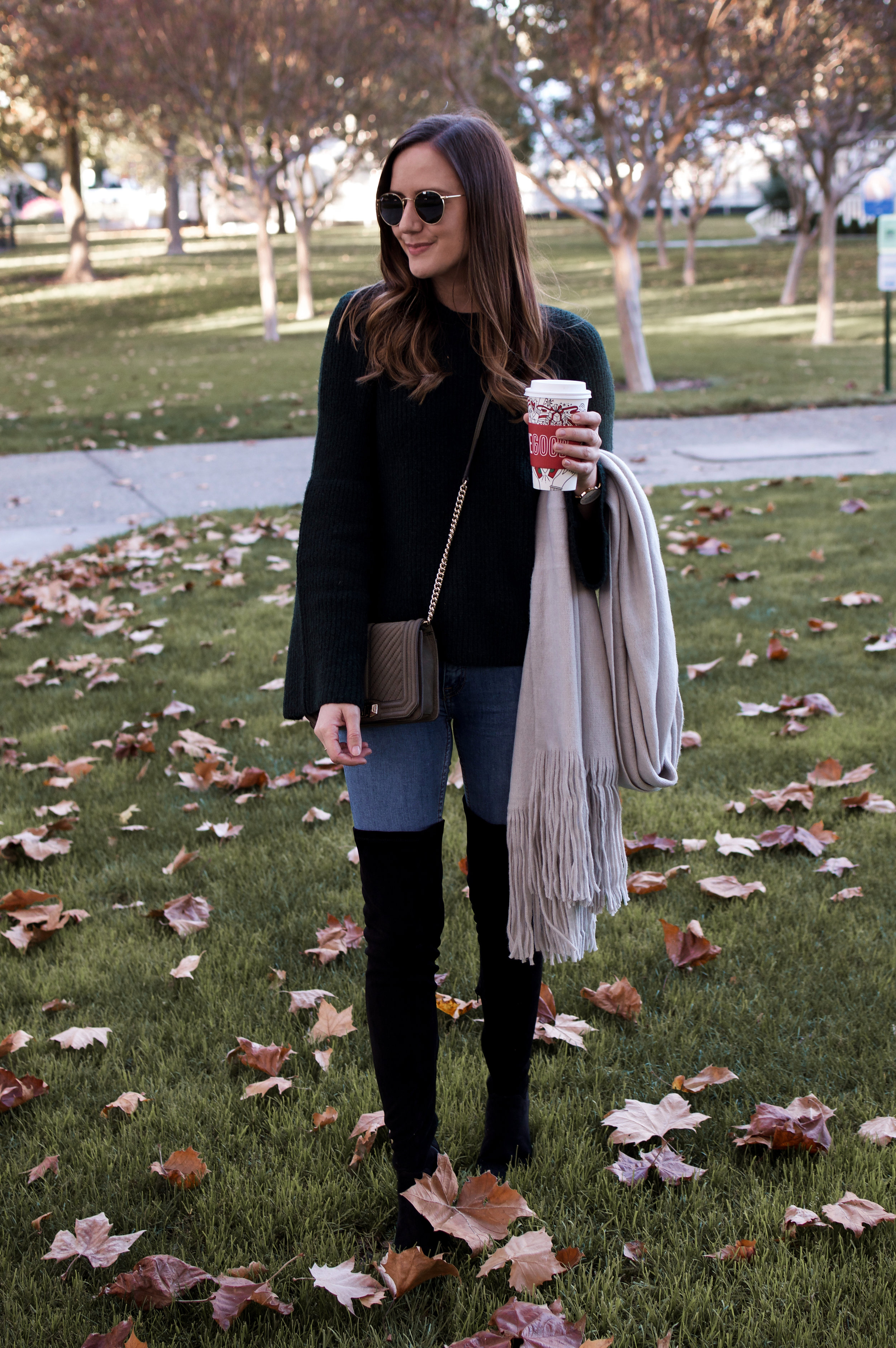 black sweater and over the knee boots