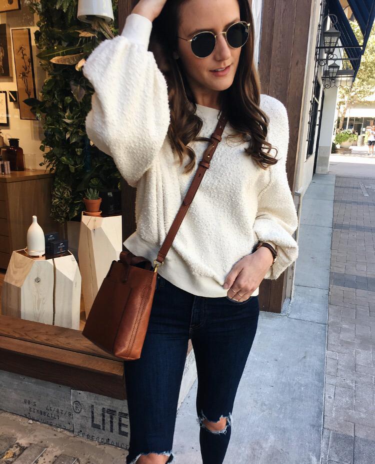 cream sweater dark wash jeans