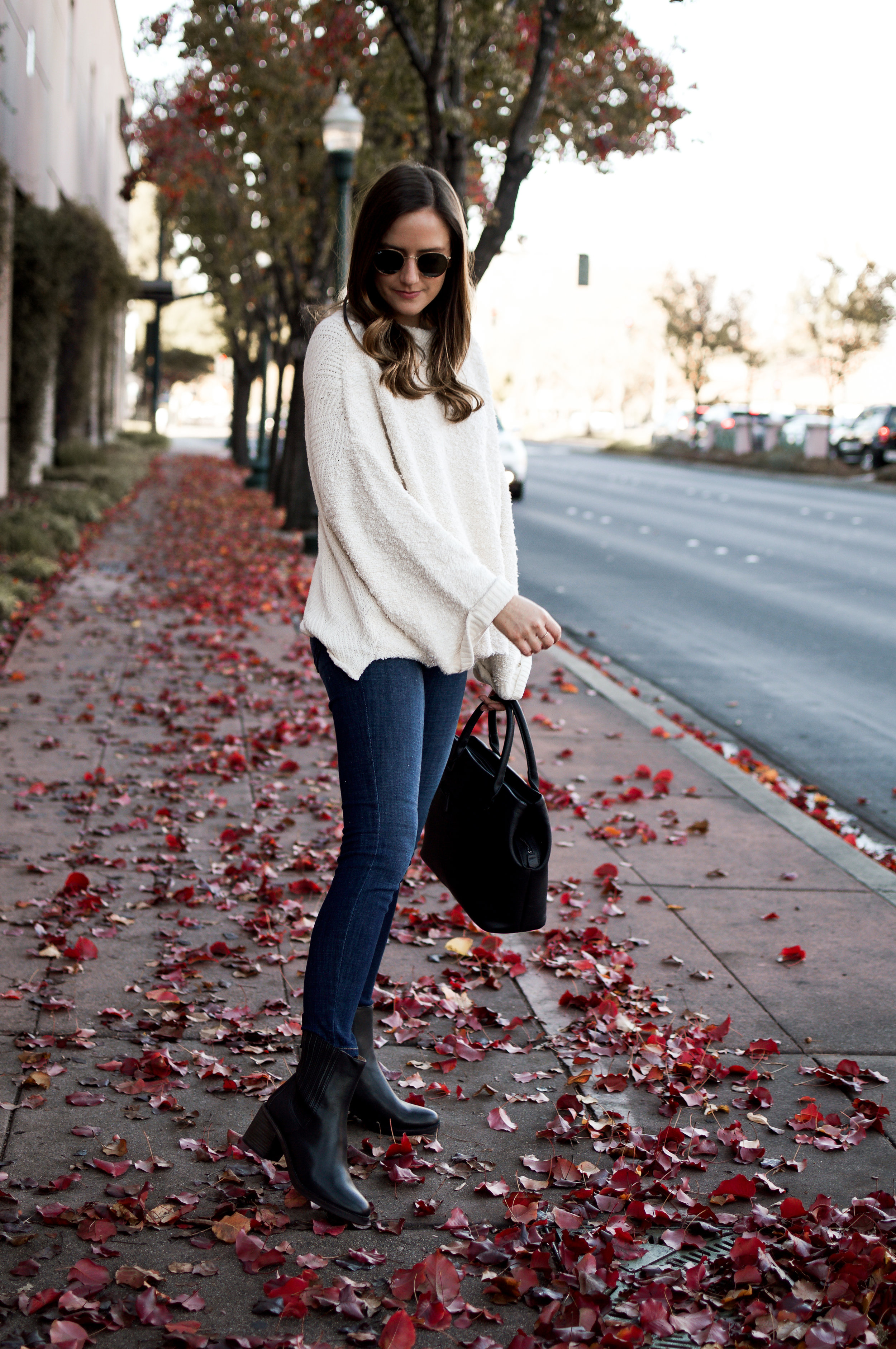 white sweater black boots