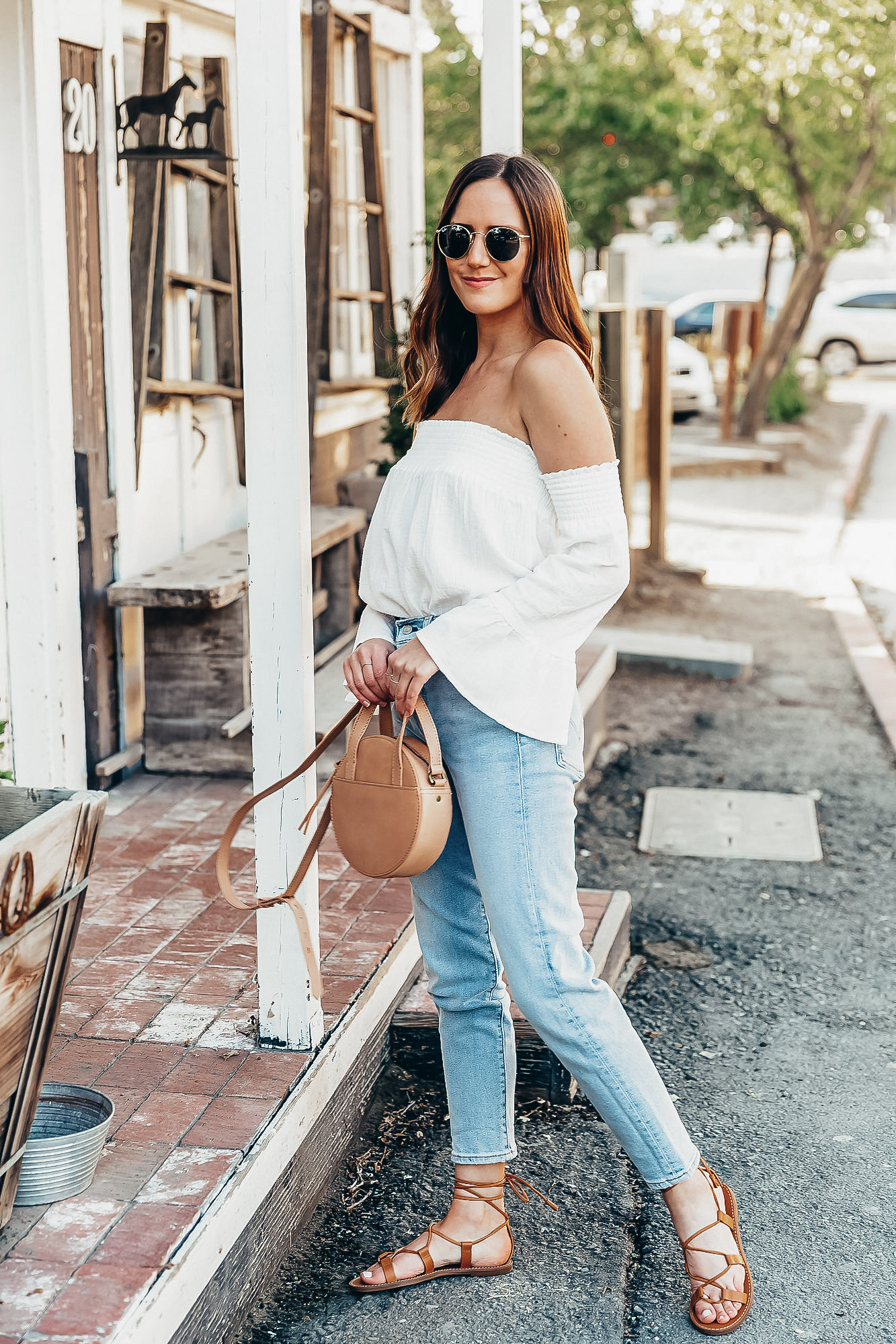 Shop the Look Below.  BB Dakota Top  |  Levi's Jeans  |  Madewell Sandals  |  Madewell Bag  |  Ray-Ban Sunglasses  |  Gorjana Rings  c/o