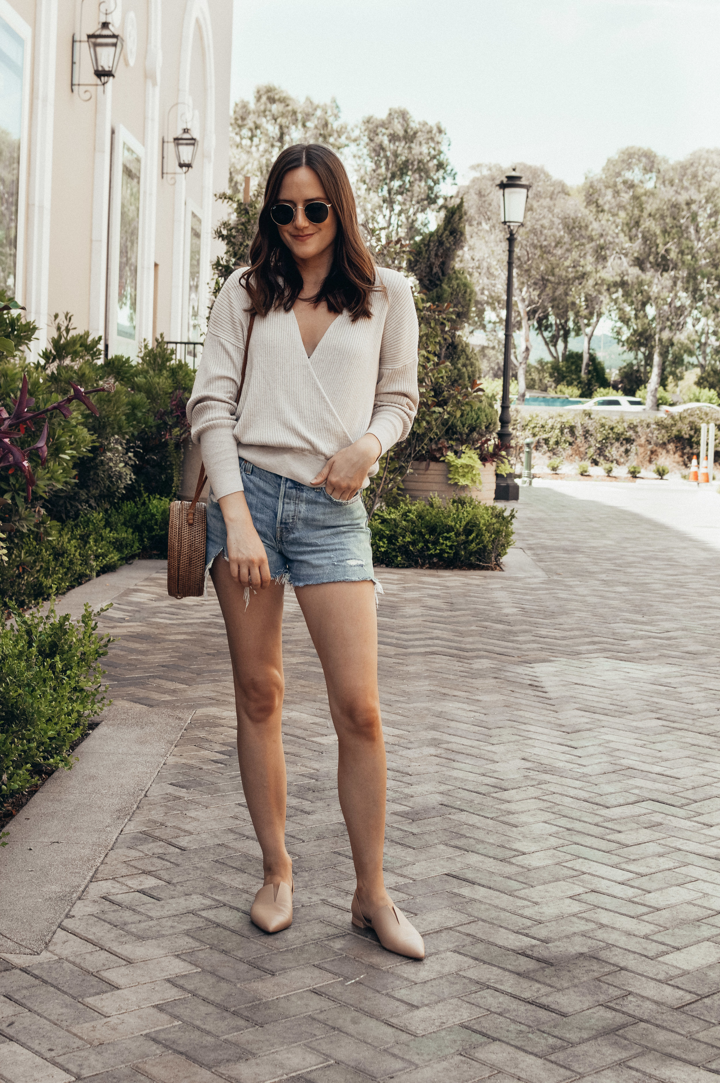 Outfit Details:  Leith Faux Wrap Sweater  |  Levi's Shorts  |  Vince Flats  |  Kinilush Bag  |  Ray-Ban Sunglasses  |  Madewell Circle Ring